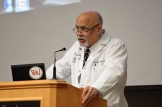Dr. Jim Phillips addresses students at the research symposium