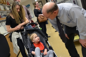 Dr. Edward Cooper with 2-year-old KCNQ2 patient Harper and her mother, Scotty Sims