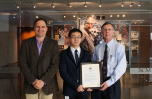 Graduate student Henry Lu, center, with Drs. Kenneth Scott and Kent Osborne