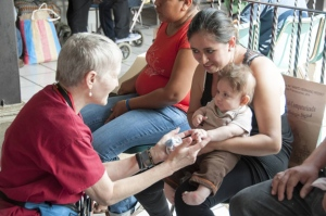Dr. Nancy Glass with a young patient in Guatemala