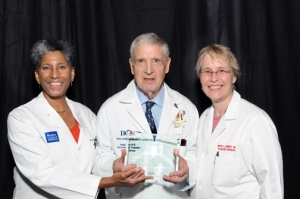 Dr. George Noon with Drs. Alicia Monroe and Mary Brandt at the 2014 White Coat ceremony, where he accepted the professionalism award.