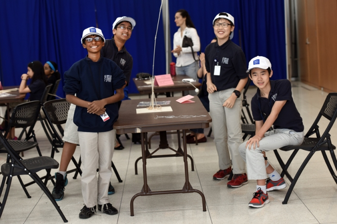 Winners of the teamwork activity don Baylor hats