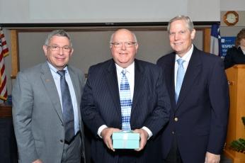 Dr. Klotman and Corbin Robertson with Dr. Fernando Stein