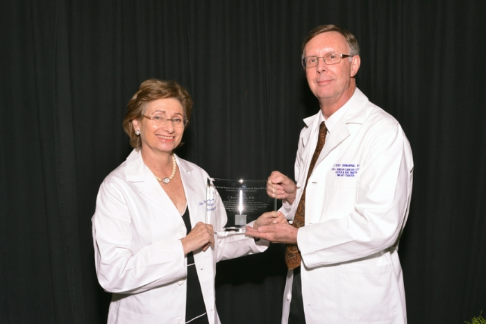 Dr. Kent Osborne accepts the Love Award from Dr. Ellen Friedman