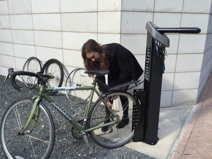 Teresa Monkkonen checks out the tire pump