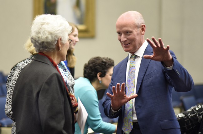 Dr. Kline talks with guests before his lecture on global health.