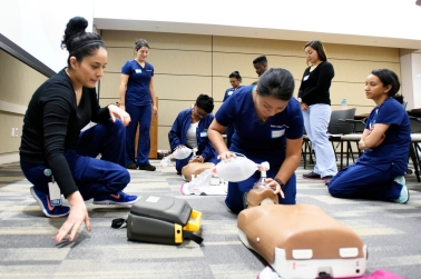 Joanna Martinez, left, leading the Basic Life Support class