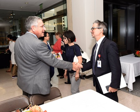 Paul Klotman greets Dr. Howard Weiner, professor of neurosurgery.