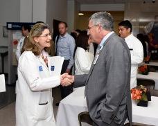 Ayse Mindikoglu, senior faculty in abdominal transplantation, meets Dr. Paul Klotman at the reception following New Faculty Orientation.