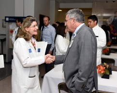Ayse Mindikoglu, senior faculty in abdominal transplantation, meets Dr. Paul Klotman at the reception following New Faculty Orientation.