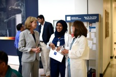 Nancy Moreno greets new colleagues.