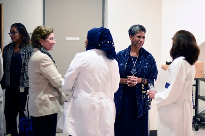 Drs. Toi Harris, Ellen Friedman and Alicia Monroe mingle with new faculty members.