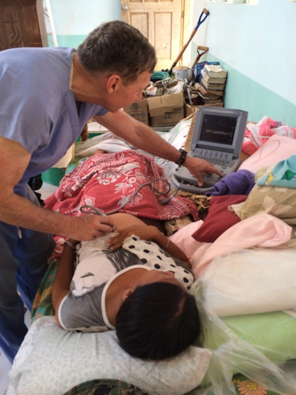 Performing an ultrasound in the Philippines.