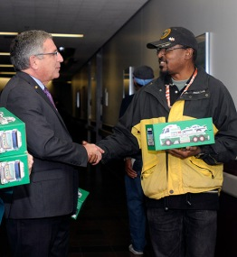 Dr. Paul Kliotman gives out the donated trucks at the VA.