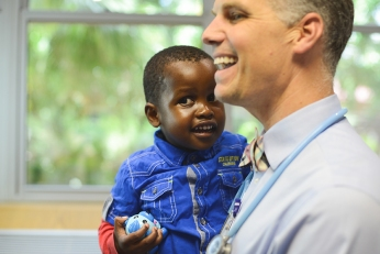 Dr. Alan Anderson of Baylor and Texas Children's Cancer and Hematology Centers with a young patient in Botswana.