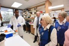 Volunteers tour the lab.