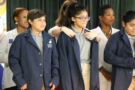 Students don their coats.
