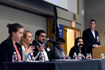 Alumni panelists talk to current students.