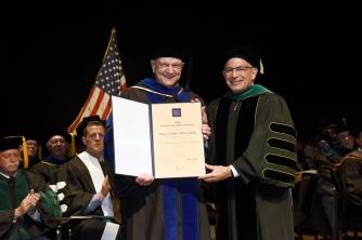 Honoring Dr. Hugo Bellen.
