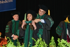 Medical student receives her ceremonial hood.