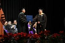 Dr. Alicia Monroe confers a degree.