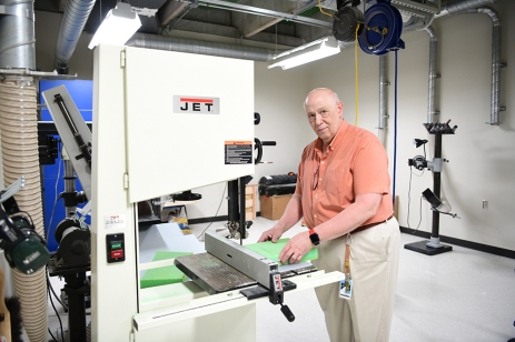 Earl Fogler helps manufacture face shields.