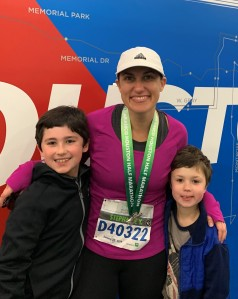 Celebrating the completion of a half marathon with her two boys!