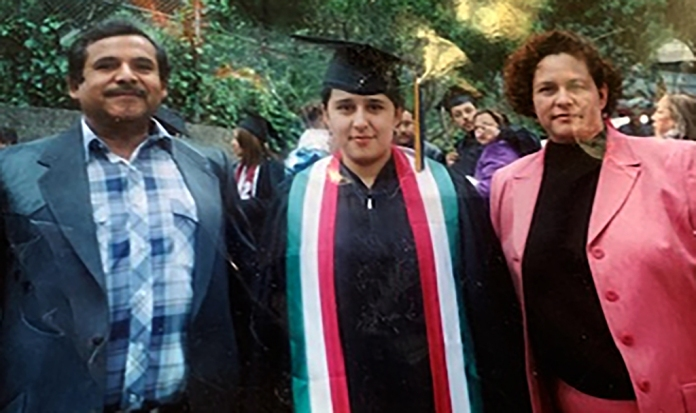 Graduation with her parents, both immigrants from Mexico.